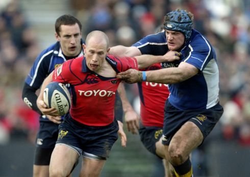 """Come here you little scamp!"" Tackling Peter Stringer on Leinster duty in 2005. Photograph: Dan Sheridan/Inpho"
