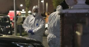 Gardaí at the scene of a shooting in Moatview Gardens, Coolock, in north Dublin on Sunday night.  Photograph:  Collins