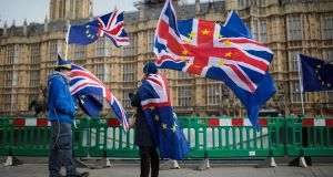 Anti-Brexit demonstrators protest  outside the Houses of Parliament, in London, England. Photograph: Jack Taylor/Getty Images