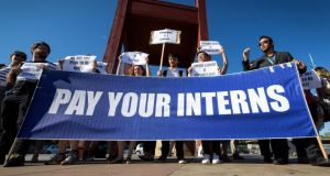 Pay your interns: unpaid United Nations interns demonstrate in Geneva last year. Photograph: Fabrice Coffrini/AFP/Getty