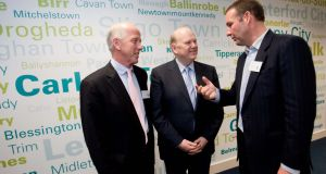 Enet chief executive Conal Henry (right, with former minister for finance Michael Noonan and Enet director Michael Tiernan) has made a surprise departure from the telco. Photograph: Kieran Clancy