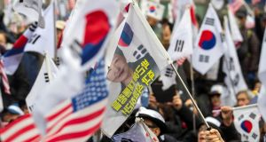 Supporters of former South Korean president Park Geun-hye protest in front of a court in Seoul on Tuesday. Photograph: Yonhap via Reuters