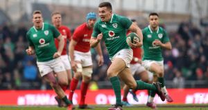 Jacob Stockdale runs in his second try against Wales at the  Aviva Stadium.  Photograph: Tommy Dickson/Inpho