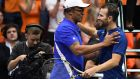 Adrian Mannarino (right) with France's team captain Yannick Noah after winning his singles tennis match in Davis Cup. Photograph:  Jean-Pierre Clatot/AFP/Getty Images