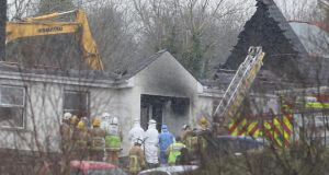 Forensic and fire officers at a house in Derrylin, Fermanagh where three people have died in a fire and police have arrested a man at the scene on suspicion of murder. Photograph: Brian Lawless/PA Wire