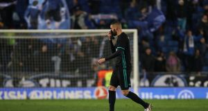 Real Madrid's Karim Benzema walks off as the home fans celebrate their win at the RCDE Stadium in Catalonia. Photograph: Sergio Perez/Reuters