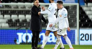 Swansea City manager Carlos Carvalhal shakes hands with Kyle Bartley after the match. Photograph: Rebecca Naden/Reuters
