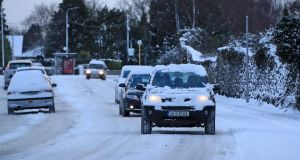 Commuters make their way in the snow this in Lucan, Co. Dublin. Photograph: Collins