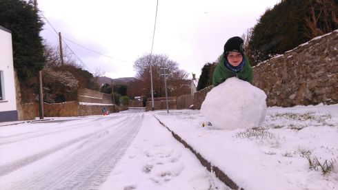 Starting a snow man in Howth. Photograph: Carlos Petecharl
