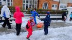 Snow fun: children playing in  Sandymount, Dublin. Photograph: Frank Miller / The Irish Times