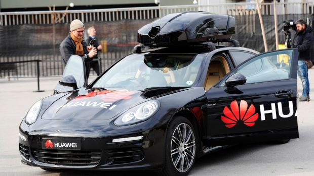 A view of a driverless Porsche car controled by Huawai's Mate 10 Pro handset that transforms a regular car into a self-driving vehicle during the presentation of Huawai's Mate 10 Pro technology at the MWC