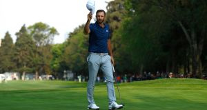 Dustin Johnson of the US celebrates  winning  the WGC-Mexico Championship at Club De Golf Chapultepec on March 5th, 2017.  Photograph:  Buda Mendes/Getty Images