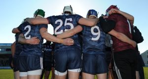 Galway in  a huddle before the encounter with Dublin. Some of the team's greenhorns could do with  more testing games than  Division 1B can provide. Photograph: Tommy Grealy/Inpho