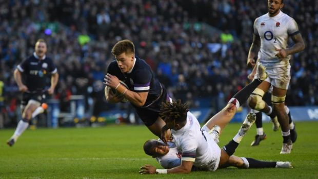 Huw Jones scores Scotland's third try against England. Photograph: Shaun Botterill/Getty