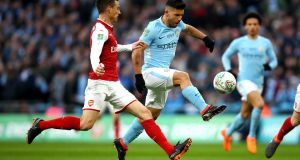 Sergio Agüero scores Manchester City's first goal in the English League Cup final win over Arsenal at Wembley last Sunday. Photograph: Julian Finney/Getty Images