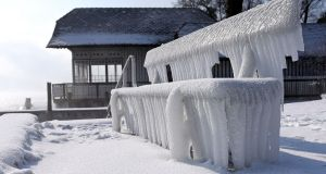 Icicles hang on a bench in a bay in the village of Attersee, Austria. Photograph: Wolfgang Spitzbart/AFP/Getty Images