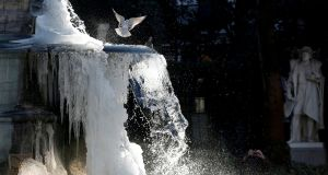 Ice partially covers the fountain of the Counts of Egmont and Hornes on a cold winter day in central Brussels, Belgium. Photograph: Francois Lenoir/Reuters