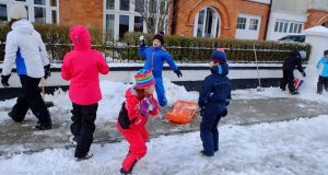 Children playing in the snow in Sandymount, Dublin. Photograph: Frank Miller/The Irish Times