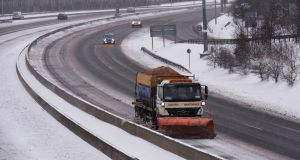 Clearing a path, a gritting snow plough on the M50 near Ballymount during the snowfall associated with Storm Emma. Photograph: Alan Betson/The Irish Times