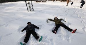 Rez and Nwa Keshani from Kurdistan, North Iraq enjoy the snow in the Phoenix park during the snowfall associated with Storm Emma - The Beast from the East. Photograph: Alan Betson/The Irish Times