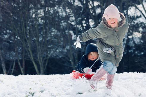 Sisters Isla and Meabh enjoying the snow in Drumcondra. Photograph: Teresa Lyons