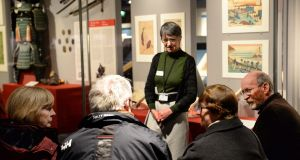 Volunteer tour guide Noleen Bryan during the Azure Tour conversation in art, dementia-friendly tours in Chester Beatty Library, with Michael and Kay Coll and Gregory and Úna Barrett. Photograph: Dara Mac Dónaill