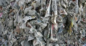 Newspapers piled up at Panda Waste Service, Ballymount Road, Dublin 12: Not only is Panda getting me to work for free, it can also fine me. Photograph: Dara Mac Dónaill