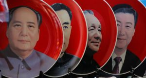Souvenir plates featuring portraits of current and late Chinese leaders (from right) Xi Jinping, Deng Xiaoping, Zhou Enlai and Mao Zedong are displayed for sale at a shop next to Tiananmen Square in Beijing, China, March 1, 2018. Photograph: Jason Lee/Reuters
