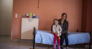 Zaineb, from Aleppo in Syria, with one of her three children at an apartment funded by the EU, in Livadia. Photograph: DG Echo