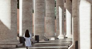 A nun among the colonnades at St Peter's Square in the Vatican. The March edition of Women, Church, World, the monthly women's magazine of the Vatican newspaper L'Osservatore Romano, highlighted that nuns cook and clean for senior Catholic clergy for next to no pay. File photograph: Getty Images