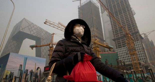 A Woman Wears A Mask As Smog Chokes Beijing Photograph Ng Han Guan