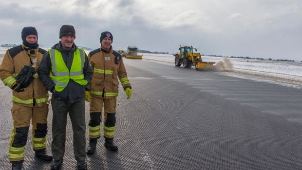 At Cork Airport are John McCarthy, Trevor Healy and Brian Culloty, part of the team ensuring safe runway clearance operations at Cork Airport. Photograph: Michael Mac Sweeney/Provision