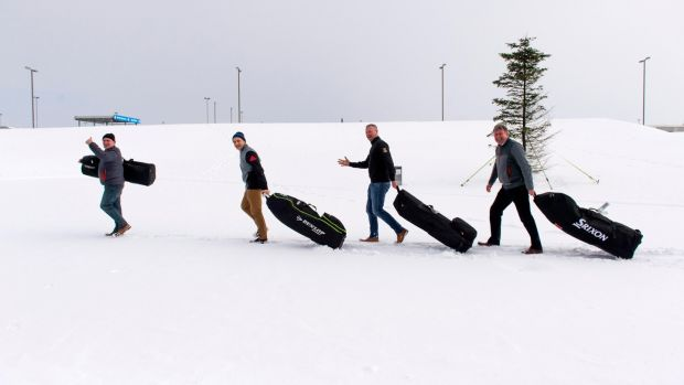 Alan O'Meara, Ronan Kelleher, Peter Wycombe and Tom Lenihan trudge through snow at Cork Airport with their bags, hoping not to suffer too much delay despite being on the way to Spain to play golf. Photograph: Michael Mac Sweeney/Provision