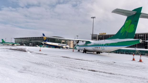 Ryanair and Aer Lingus flights sit on the snow-covered apron at Cork Airport. Photograph: Michael Mac Sweeney/Provision