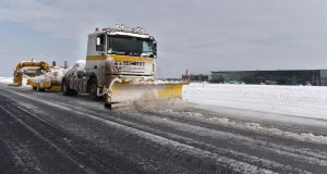 A snowplough plies its trade at Cork Airport. Photograph: Michael Mac Sweeney/Provision