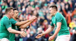 Ireland's Jacob Stockdale celebrates his try against Wales with Conor Murray and Chris Farrell. Photograph: Tom Honan/The Irish Times