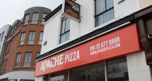 The Apache Pizza outlet on Pearse Street, Dublin 2. Robert Pendleton, who co-founded Apache in 1996 along with his wife Emily Gore Grimes,  will stay on as managing director of the group. Photograph: Brenda Fitzsimons