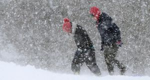 Walkers in the snow on the Curragh in Co Kildare. Photograph: Niall Carson/PA Wire