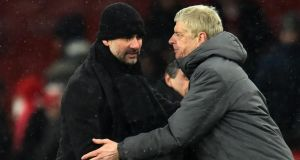 Arsenal manager Arsene Wenger and Manchester City manager Pep Guardiola shake hands after City's 3-0 Premier League win at the Emirates. Photo: Glyn Kirk/Getty Images