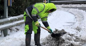 Workers clearing paths in Clonee, Co Meath  on Thursday. Photograph: Colin Keegan, Collins.