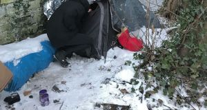 A safety net nurse checks on someone in a tent on Thursday.