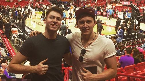 Eamon Donoghue, right, with his friend Colin Brennan watching a Miami Heat basketball game at the American Airlines Arena, Miami, Florida.