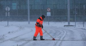 Veolia staf sweeping and salting the Luas Platform at the Red Cow, Dublin. Photograph: Gareth Chaney Collins