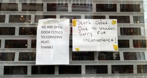 Shops in Dublin putting up notices of closure due to adverse weather. Photograph: Brenda Fitzsimons