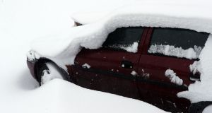 Cars buried in snow in Naas, Co Kildare, as the severe weather conditions continue. Photograph: Niall Carson/PA Wire