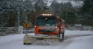 A snow plough tries to clear the N11 at Glen of the Downs on Friday morning. Photograph: Nick Bradshaw