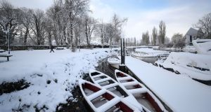 Snow-covered boats on the river Barrow in Athy, Co Kildare. Photograph:  Niall Carson