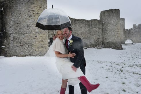 Claire Doggett and Gary Conroy brave the elements after getting special dispensation to get married at  Trim Castle Hotel  during the snowfall associated with Storm Emma &  The Beast from the East Photograph: Alan Betson / The Irish Times