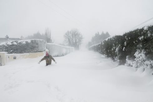 A woman makes her way through a snow drift  in Rathmore, Co Kildare, just a five minute drive from the N81 close to Blessington.  Photograph: Niall Sargent / The Green Diary
