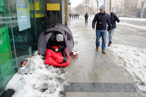 A man camped out in the snow on O'Connell Street Dublin during Storm Emma.  Photograph: Frank Miller / The Irish Times